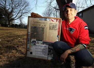 Eric DeCicco of Peabody poses with memorabilia of past Pats celebrations.
